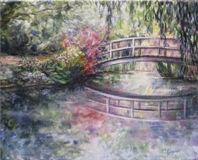 A Bridge in the garden and it's reflection in the water below